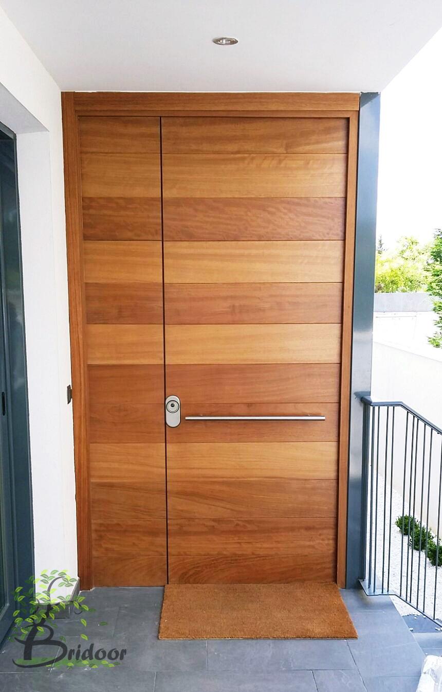 Bridoor s l vivienda moderna en valdemoro for Puertas de madera minimalistas