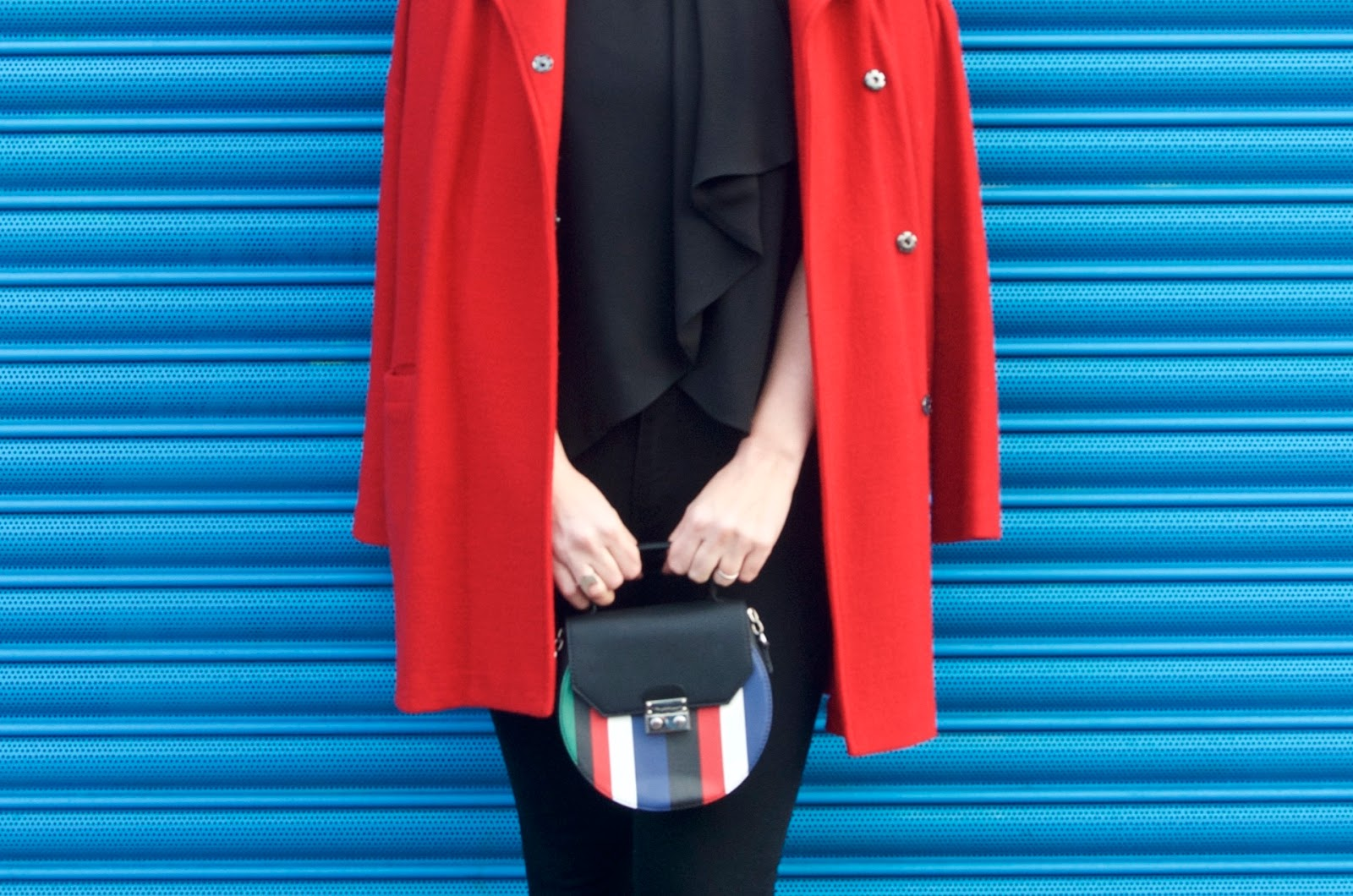 black, red, blue, green and white stripe round bag