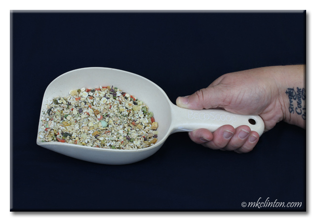 BeCo food scoop with Dr. Harvey's Canine Health dog food in it.