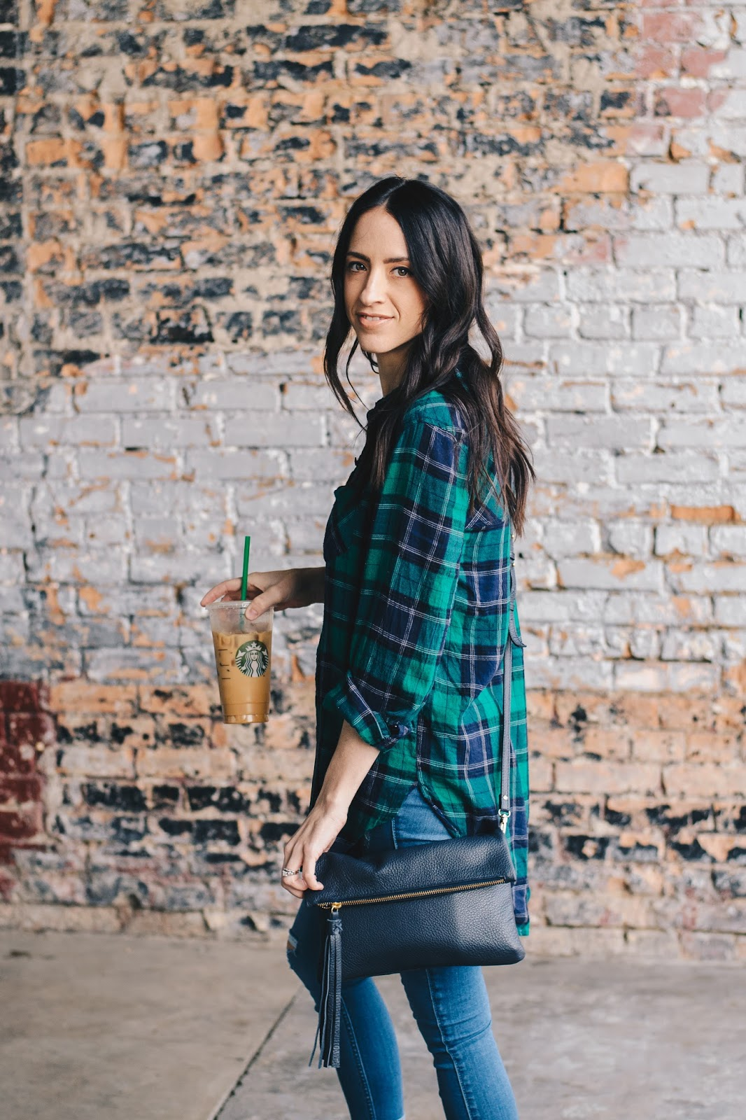 Navy fringe cross body bag and a casual plaid top