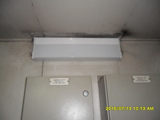 Installing lamp in corridor area 2