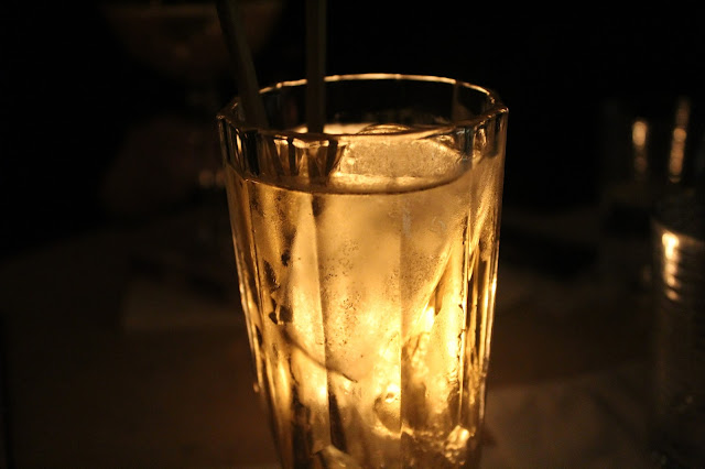 A glass of candle-lit Czech cocktail