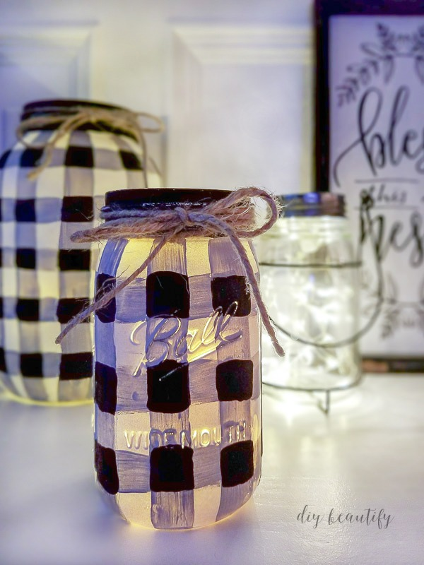add fairy lights to painted mason jars | diy beautify