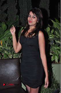 Actress Kavya Kumar Stills in Black Short Dress at F Club pre soft Launch  0019.JPG