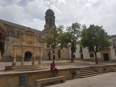 The fountain, the arch, and the church in Baeza