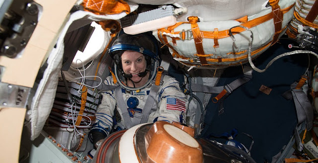 NASA astronaut Kate Rubins is pictured inside of the Soyuz MS-01 spacecraft while conducting routine spacesuit checks. Rubins, suited up in a Russian Sokol Launch and Entry suit, was conducting leak checks in advance of her upcoming landing along with Japan Aerospace Exploration Agency astronaut Takuya Onishi and cosmonaut Anatoly Ivanishin of the Russian space agency Roscosmos. Photo Credit: NASA