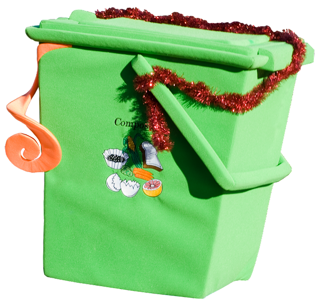 A green compost bin, decorated for Christmas.