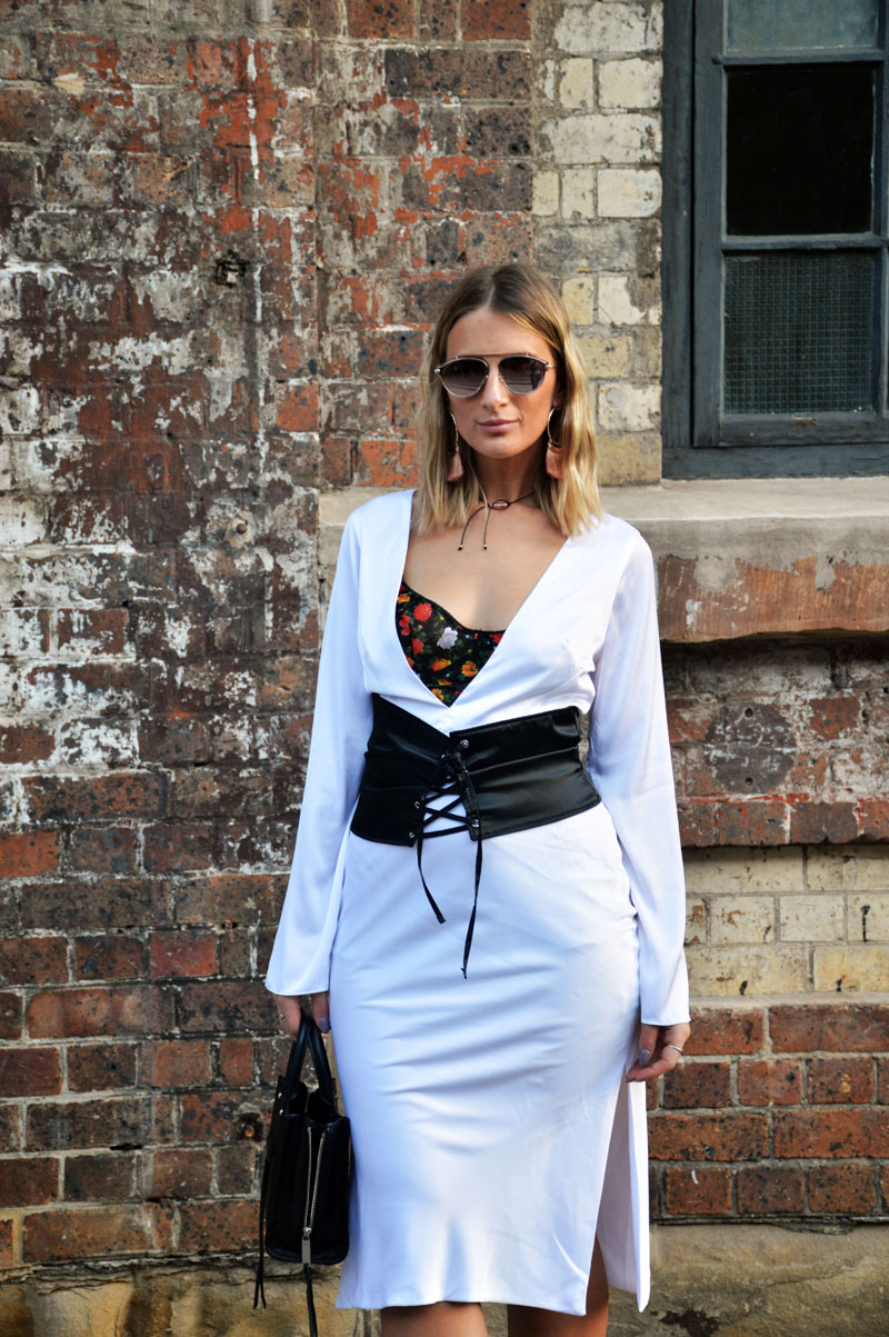 fashion week street style sydney mbfwa dyspnea white slip dress layered over dolce gabbana floral slip black corset belt