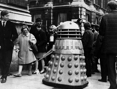 18th November 1967:  A dalek, featured in the TV programme 'Dr Who', menaces passers by in the street for donations.  (Photo by A. Jones/Evening Standard/Getty Images)