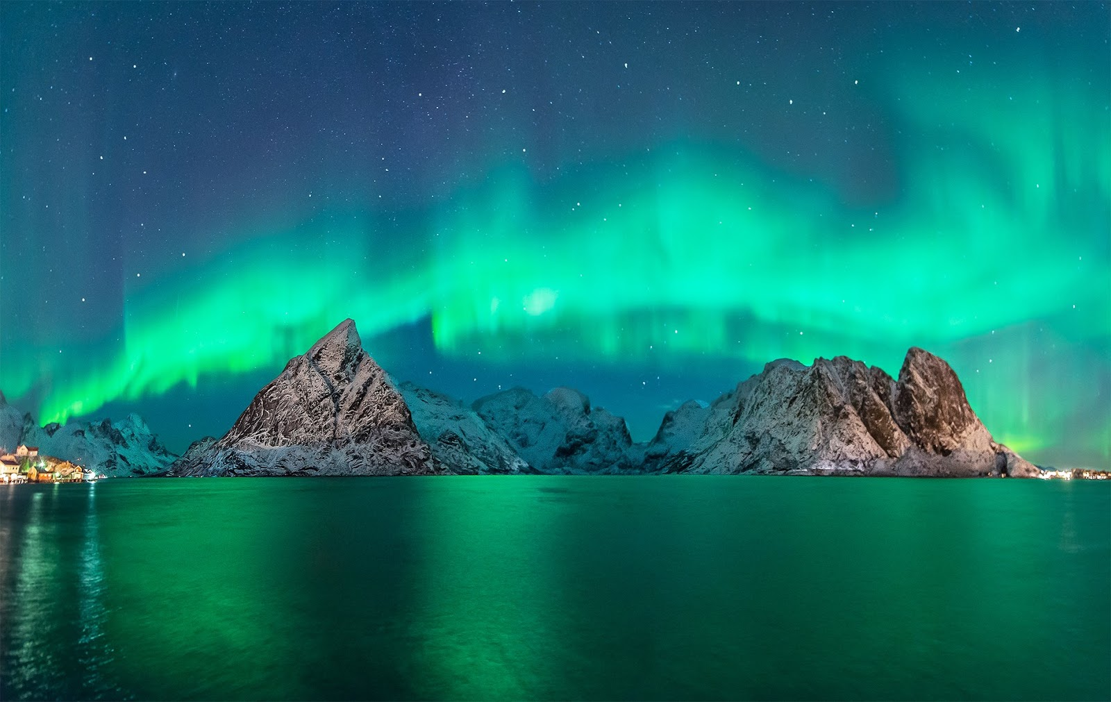 The ever-elusive Northern Lights blaze across winter skies in Vidar Lysvold, Henningsvær on the main island of Austvågøy, Norway.