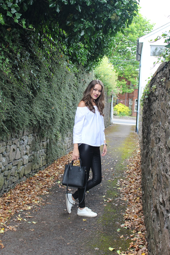 black and white outfit and trainers