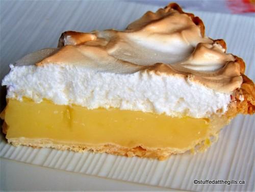 A slice of Classic Lemon Meringue Pie.