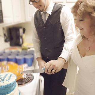 both couple cutting cake