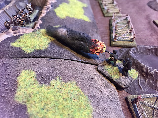 A British rifle section is consumed by the flames!