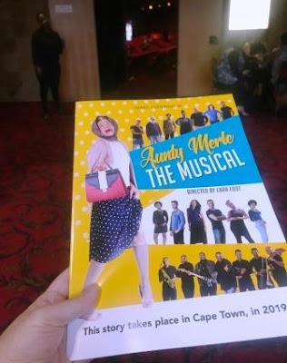 Aunty Merle the Musical programme in hand in front of Theatre