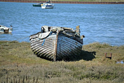 An old boat on the river bank