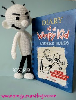 white crochet doll with book