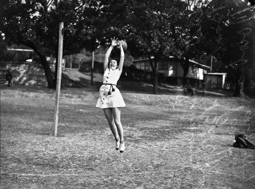 Audrey Salmon playing netball at Mowbray Park, Brisbane, 1947 State Library of Queensland. Snapshot of Audrey mid jump, just missing the ball. Only Two Plays marchmatron.com