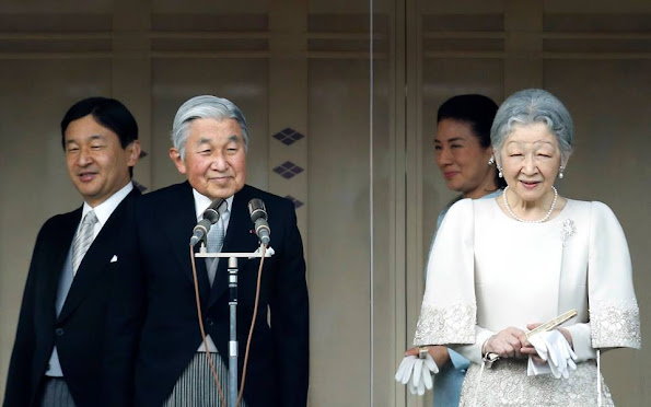 Members of the Imperial family wave to well-wishers during the celebration for the New Year on the veranda of the Imperial Palace