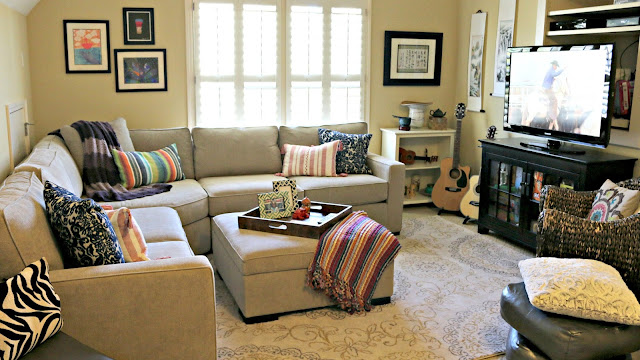 Family bonus room with bohemian pillows, rug and global accent pieces