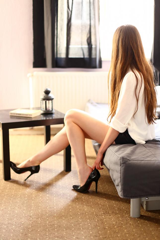 long hair white shirt black heels outfit