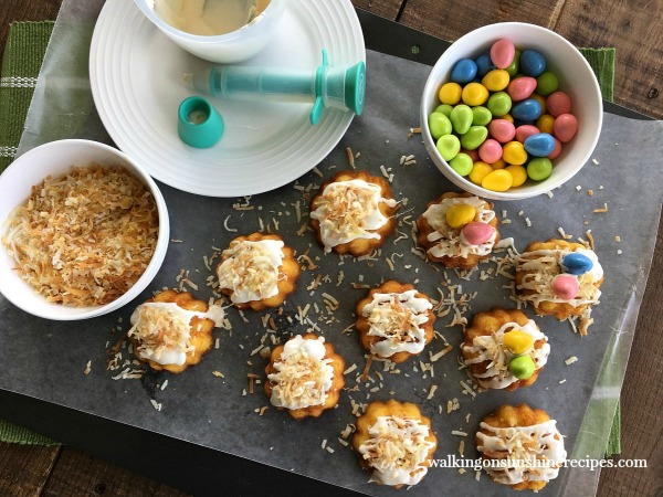 Mini Bundt Cakes for Easter being decorated with coconut and candies from Walking on Sunshine