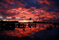 Villagers watch the sunset over a small lagoon near the village of Tangintebu on South Tarawa in the central Pacific island nation of Kiribati May 25, 2013. (Credit: Reuters/David Gray/File Photo) Click to Enlarge.