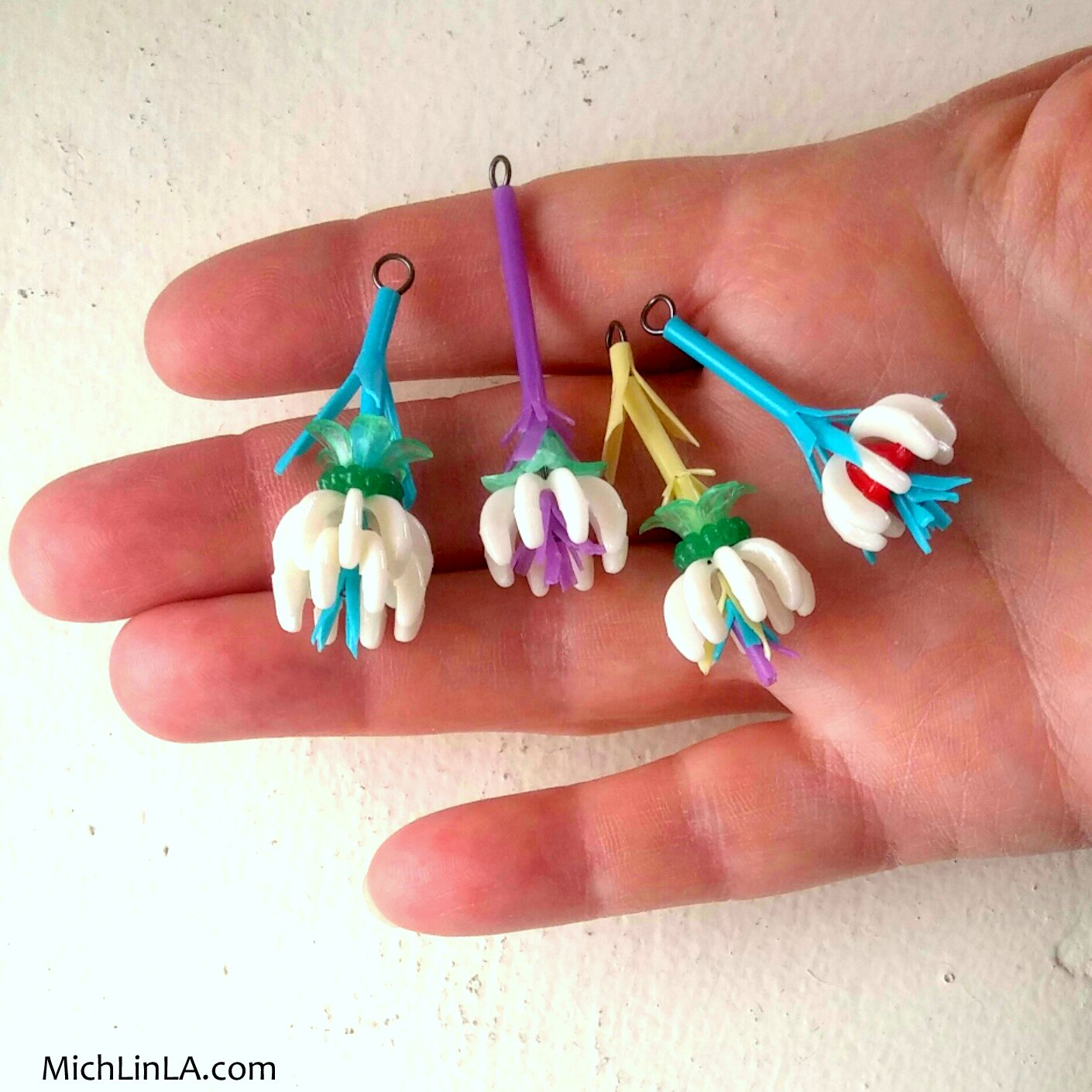 Some of you have no doubt guessed the upcycle: these inexpensive, brightly  colored plastic Q-Tips.