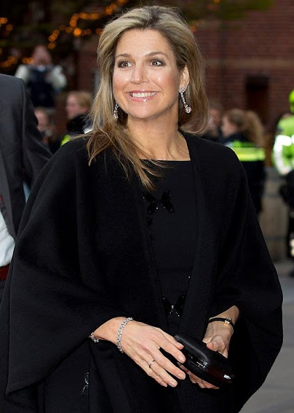 Queen Maxima in Rotterdam. Queen wore Natan Dress, Christian Louboutin pumps, diamond gold earrings, new winter dress