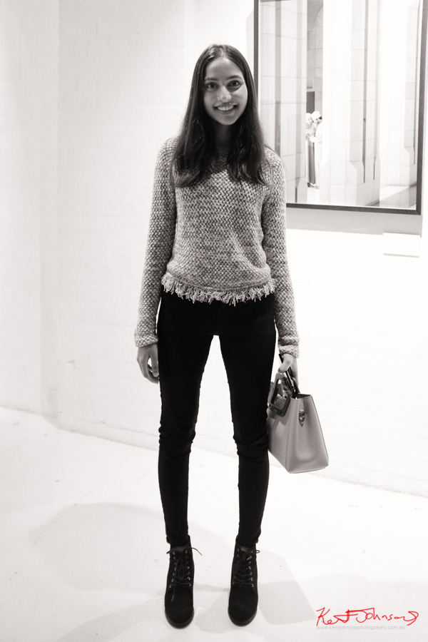 A young woman in a woven top and black jeans at Vandal - Photography by Kent Johnson for Street Fashion Sydney.
