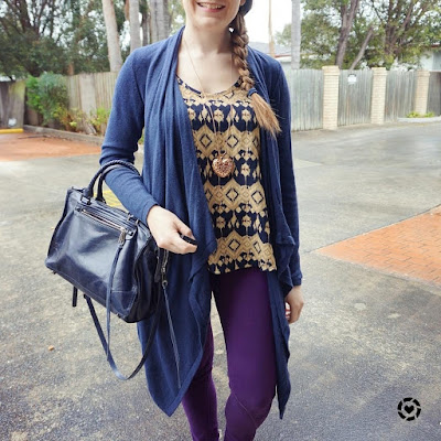 Awayfromtheblue instagram | Wearing a navy cardigan with purple skinny jeans and aztec print gold tank