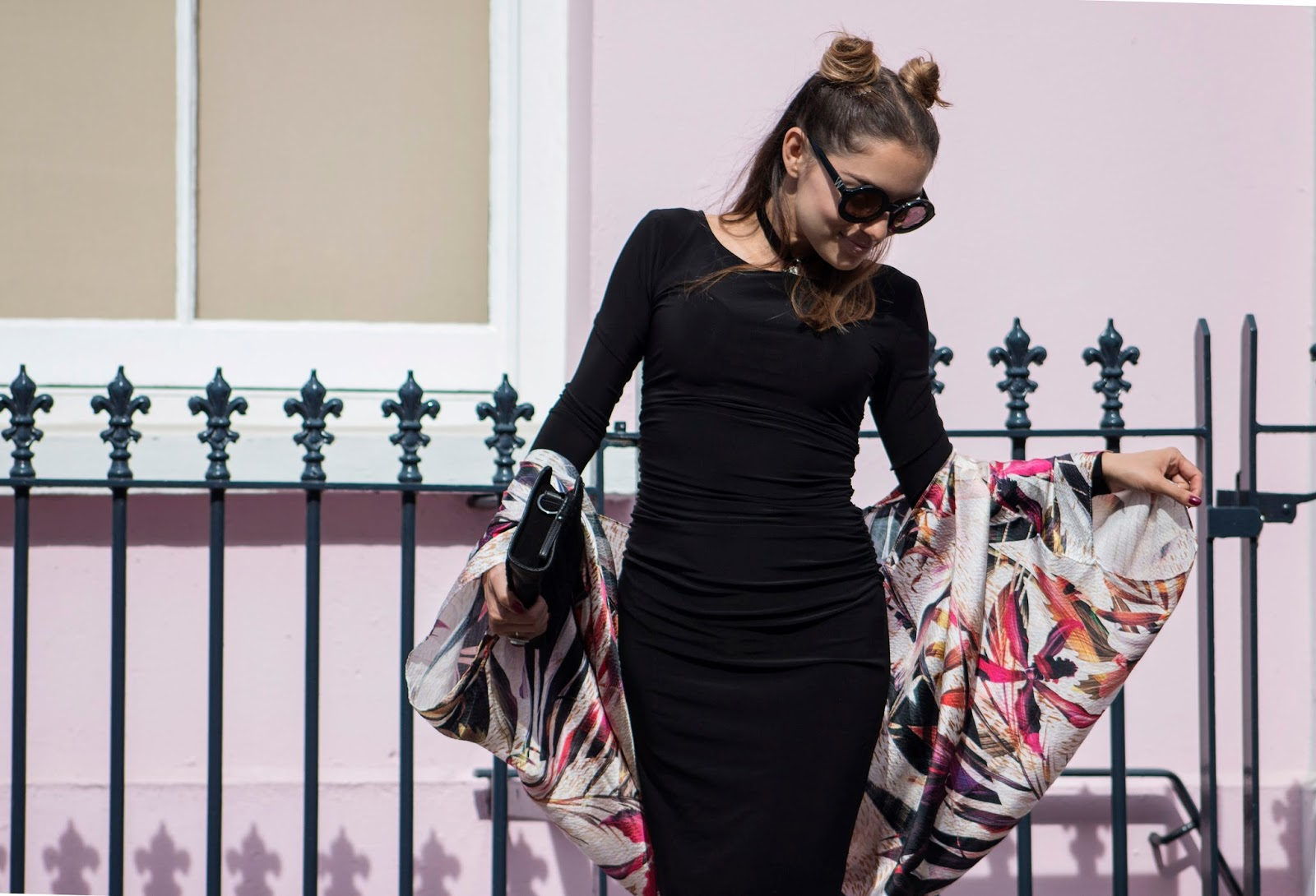 Whitney's Wonderland's Whitney Valverde UK Top Luxury Fashion Blogger wears Nooki cape exclusive to The Dressing Room, Kamali Kulture black dress, Rock 'n Rose choker, Wildfox twiggy sunglasses and Sam Edelman black pointy heels