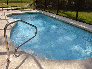 A picture of an above ground pool in a back yard. This article is about, above ground pool leak and fixing it