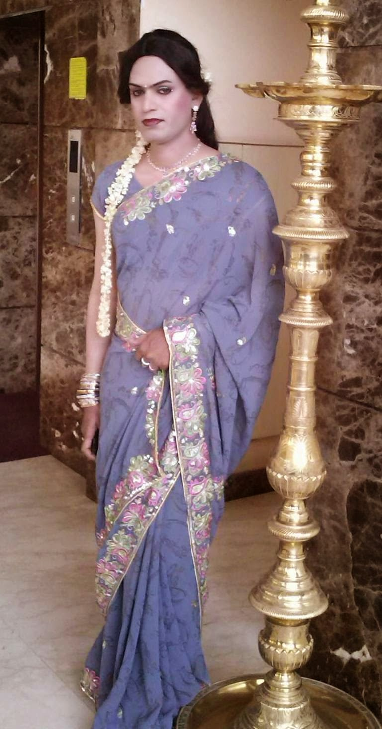 beautiful boy wearing saree