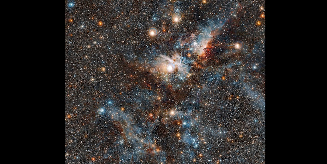 This spectacular image of the Carina nebula reveals the dynamic cloud of interstellar matter and thinly spread gas and dust as never before. The massive stars in the interior of this cosmic bubble emit intense radiation that causes the surrounding gas to glow. By contrast, other regions of the nebula contain dark pillars of dust cloaking newborn stars.  Credit: ESO/J. Emerson/M. Irwin/J. Lewis