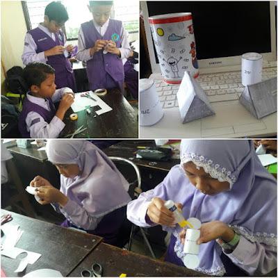 Kegiatan mengunting melipat dan menempel bahan pepercraft pada pembuatan media PBR (Papercraft Bangun Ruang)