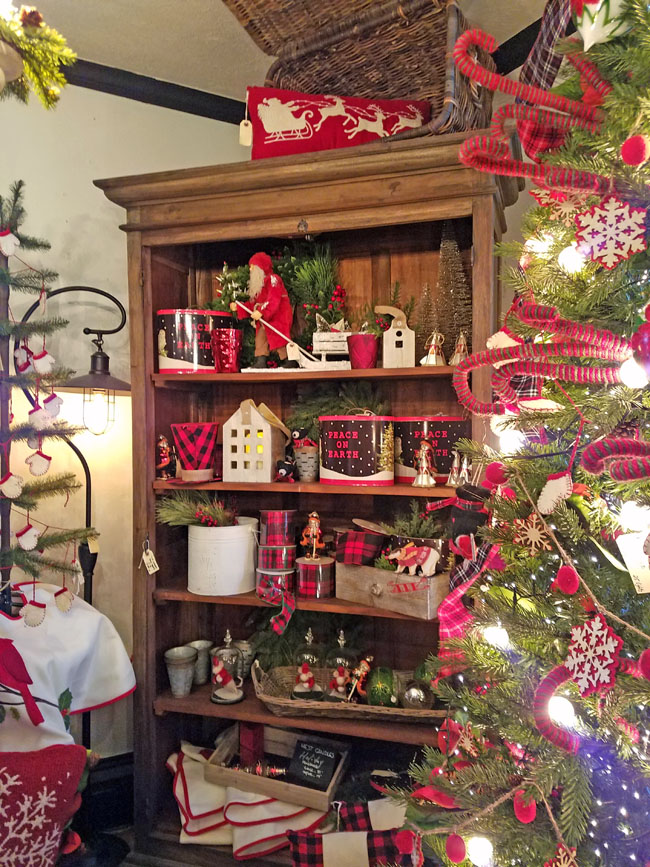 dark wooden bookcase decorated for Christmas