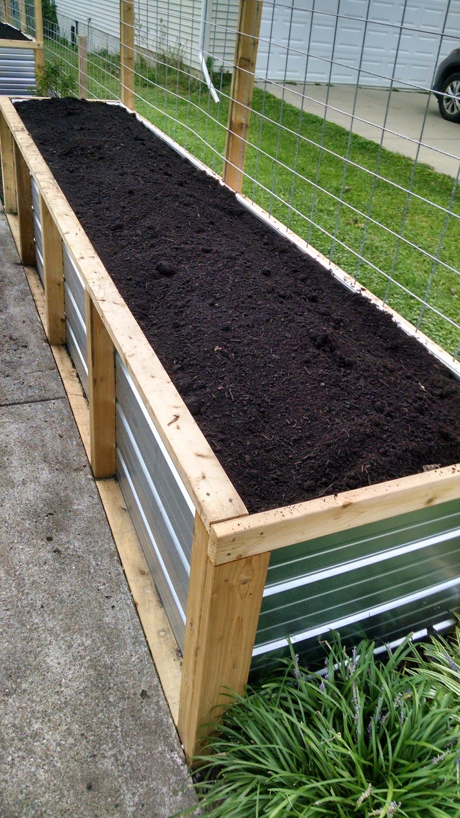 Abundant Design Raised Beds of Steel with a Hugelkultur