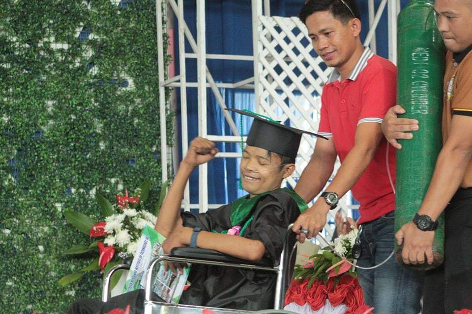 Student with rheumatic heart disease defies odds, attends graduation with tank
