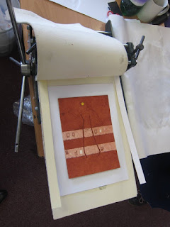 Photograph of printing board in place on printing press ready for printing