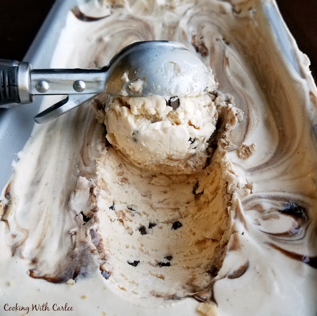 scooping out a ball of ice cream with chocolate ribbon