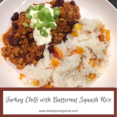 Turkey chilli with butternut squash rice topped with yoghurt and spring onion
