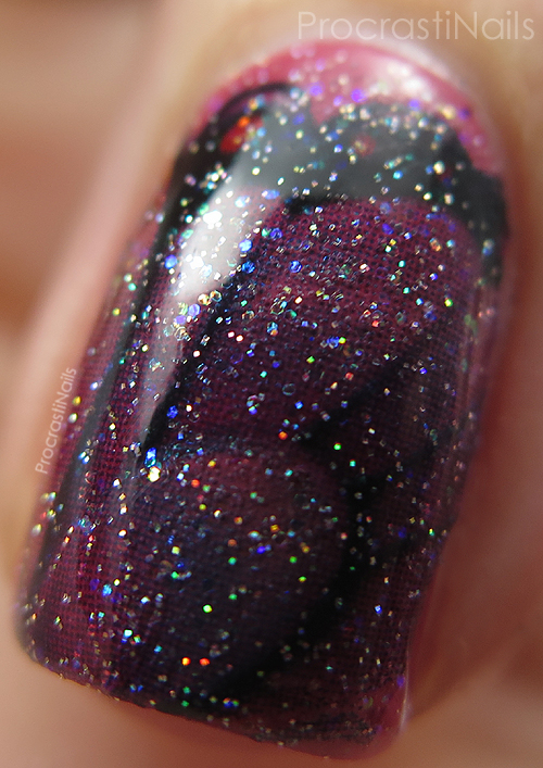 Macro of China Glaze Fairy Dust over butterfly wing nail art