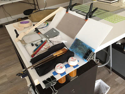 plein air painting setup cobbled together from various supplies