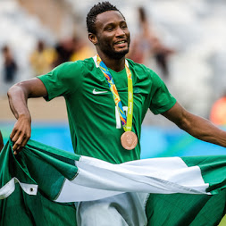 Mikel Obi with the Nigeria flag