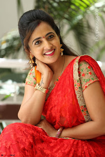 Lasya Looks Really cute in Red Saree Smiling Beauty