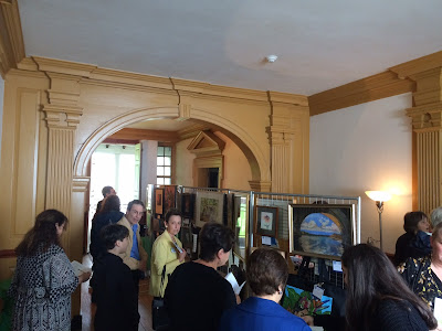 Display of artwork at Hope Lodge during art center fundraiser