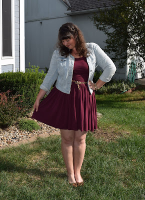 an outfit with a red dress, denim jacket, leopard flats, and a leopard belt