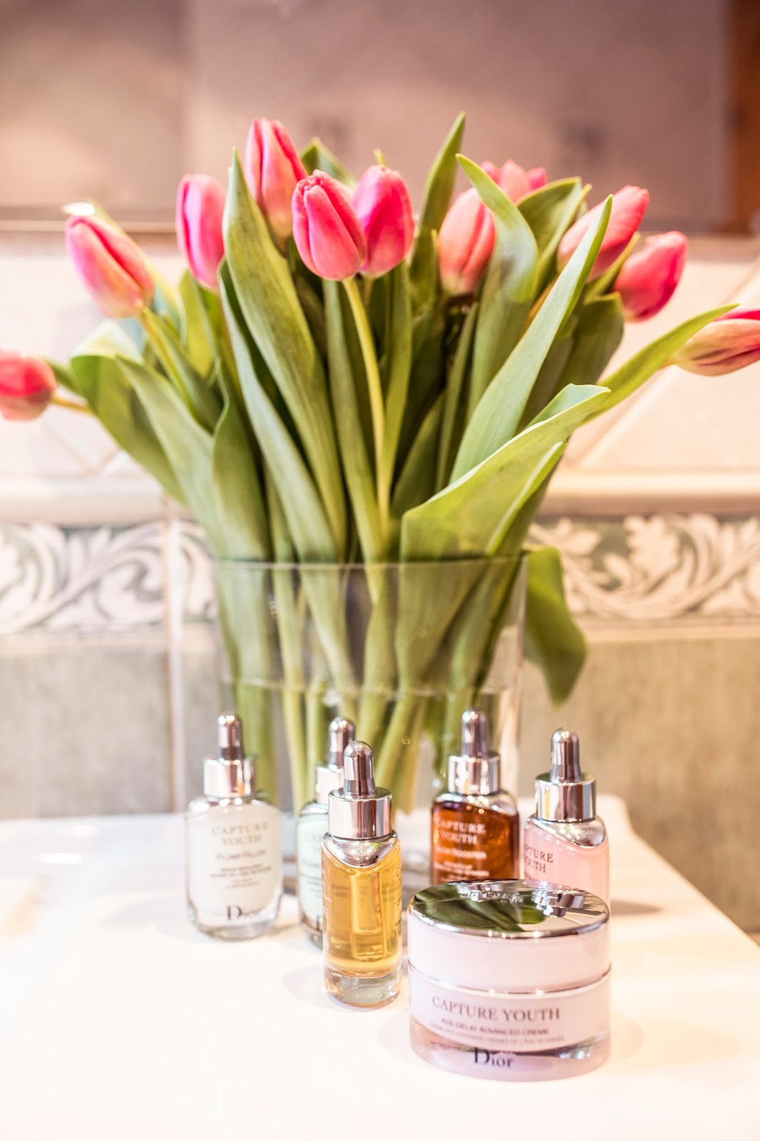 dior beauty skincare products bathroom desk flowers
