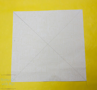 X on white block to make half square triangles
